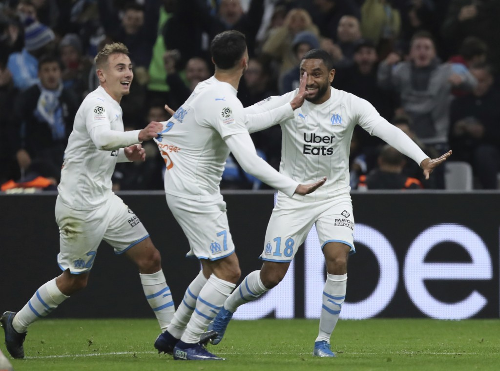 Marseille's Nemanja Radonjic, centre, celebrates with teammates after scoring his side's second goal during the French League One soccer match between...