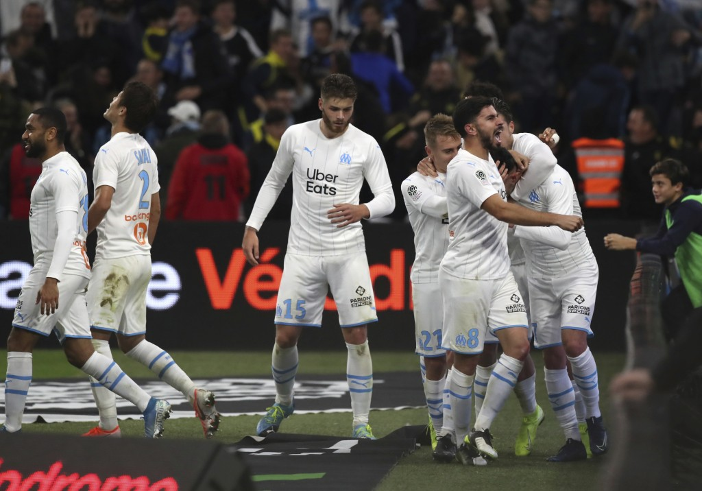 Marseille players celebrate after Marseille's Nemanja Radonjic scored his side's second goal during the French League One soccer match between Marseil...