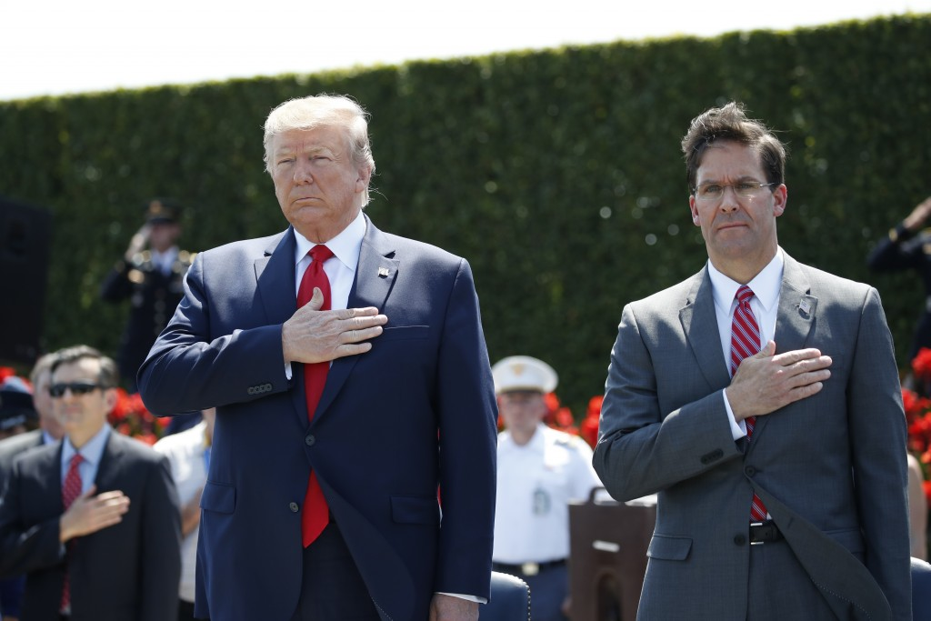 FILE - In this July 25, 2019, file photo, President Donald Trump and Secretary of Defense Mark Esper, right, stand during the playing of the National ...