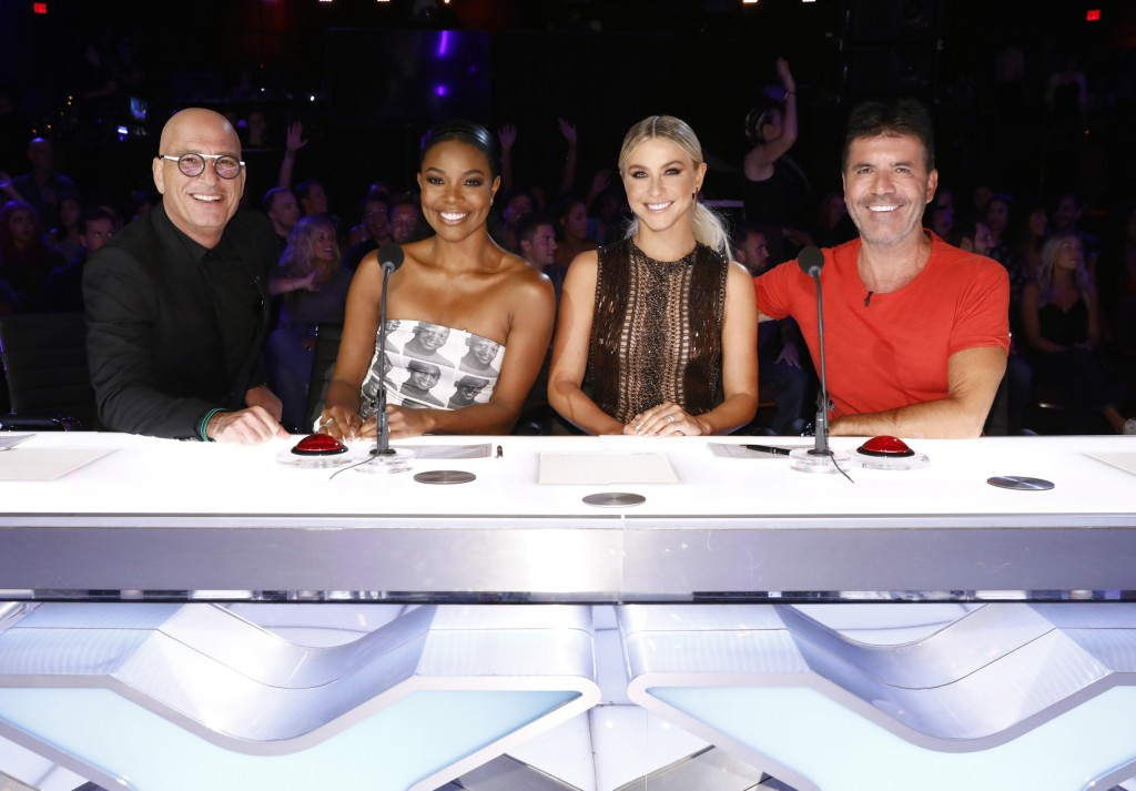 "This image released by NBC shows celebrity judges, from left, Howie Mandel, Gabrielle Union, Julianne Hough, Simon Cowell on the set of ""America's Got..."