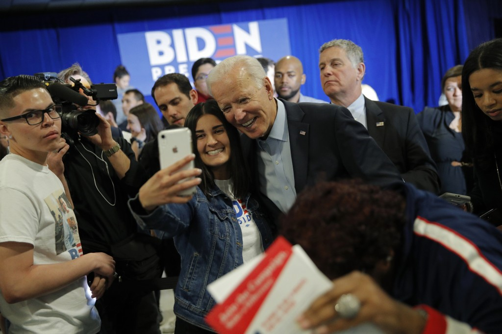 FILE - In this Nov. 16, 2019, file photo, Democratic presidential candidate former Vice President Joe Biden poses for a selfie at a campaign event in ...