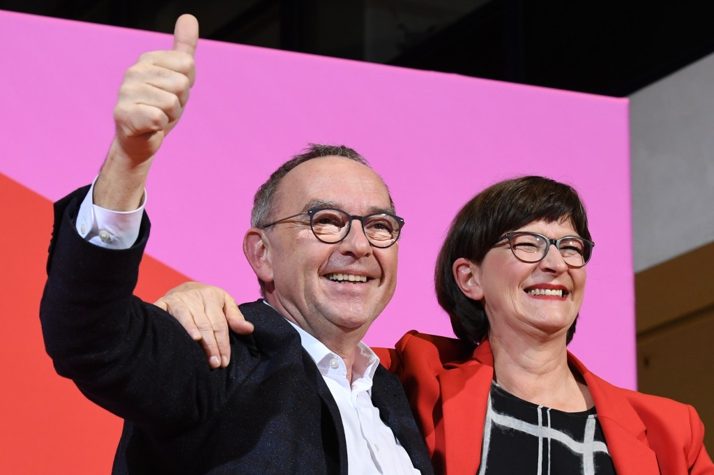 Norbert Walter-Borjans, left, and Saskia Esken celebrate after winning the member voting of the Social Democratic Party, SPD, chairmanship at the part...