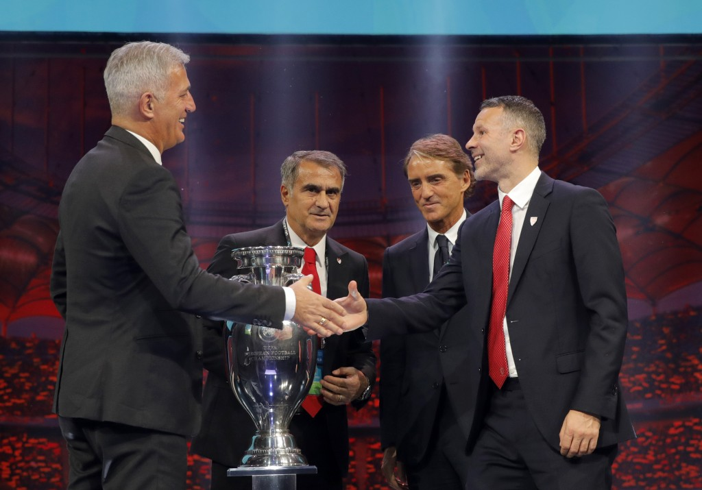 The coaches of Switzerland Vladimir Petkovic, left, Turkey Senol Gunes, second left, Italy Roberto Mancini, second right, and Wales Ryan Giggs who wil...