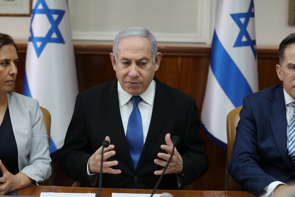 Israeli Prime Minister Benjamin Netanyahu attends the weekly cabinet meeting at his office in Jerusalem, Israel, Sunday, Dec. 1, 2019. (Abir Sultan/Po...