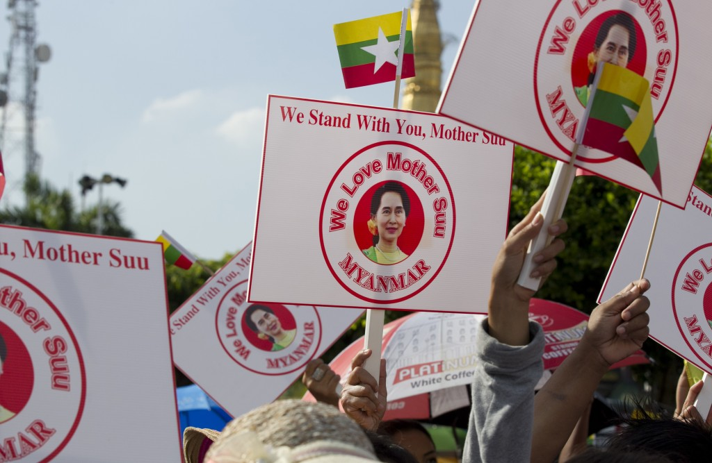 People hold placards with picture of Myanmar leader Aung San Suu Kyi during a rally Sunday, Dec. 1, 2019, in Yangon, Myanmar. About 700 people rallied...