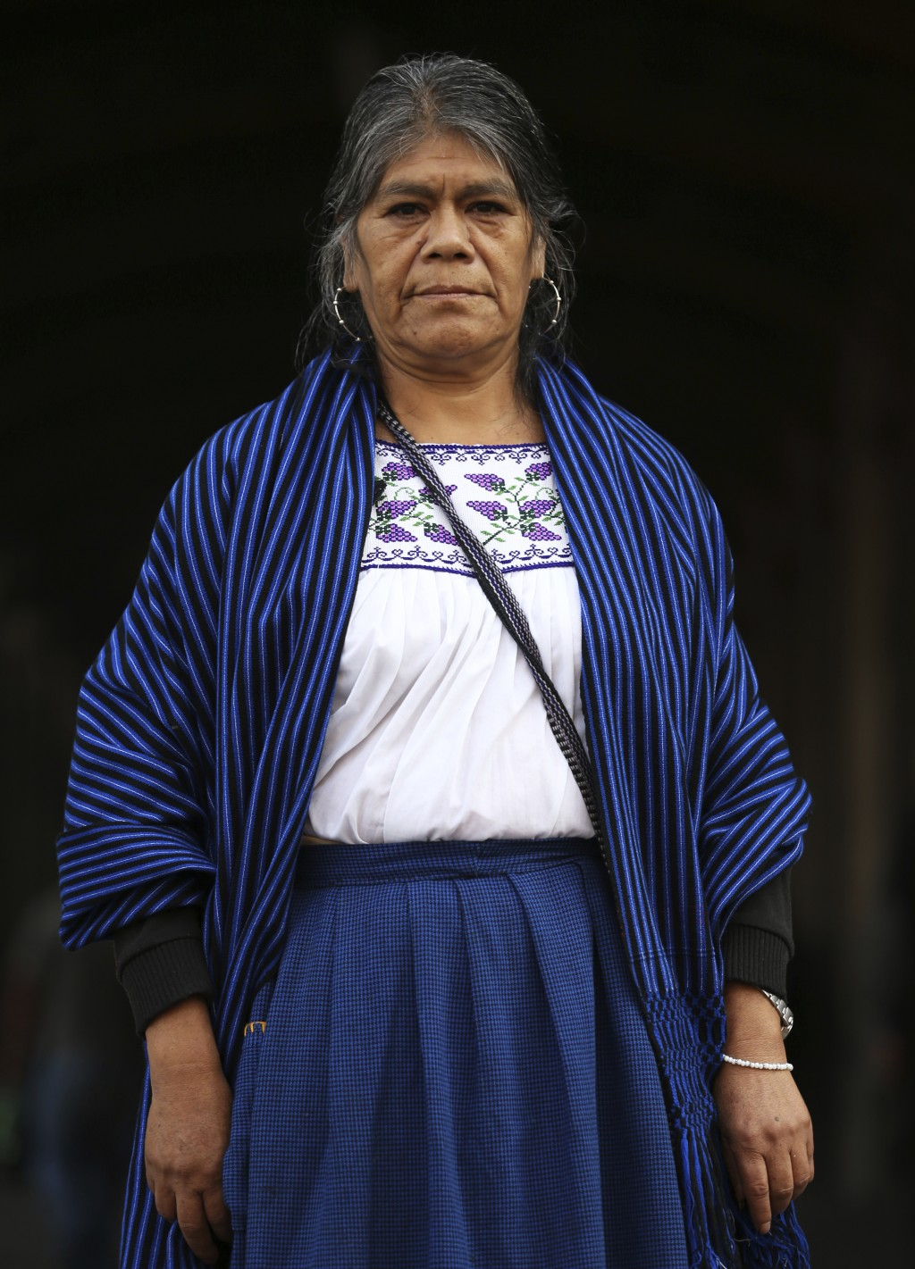 Maria Sara Guzman poses for a photo during an interview in the Zocalo in Mexico City, Friday, Nov. 29, 2019. An artisan from the Purepecha indigenous ...