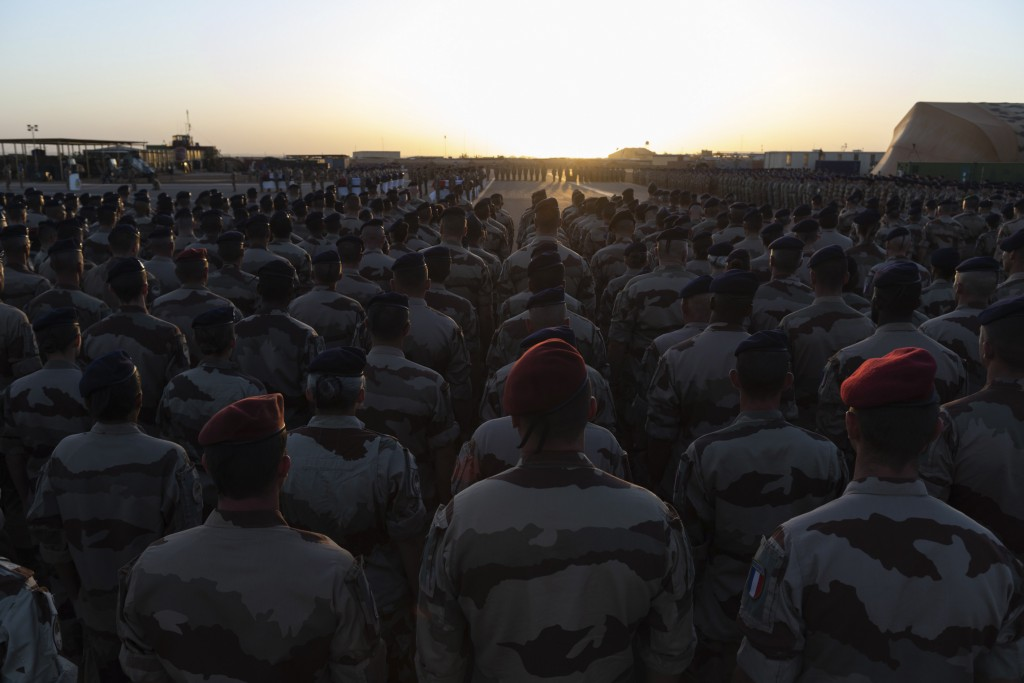 In this Saturday, Nov. 30, 2019 photo provided by French Defense Communication and Audiovisual Department (ECPAD), French soldiers attend a ceremony b...