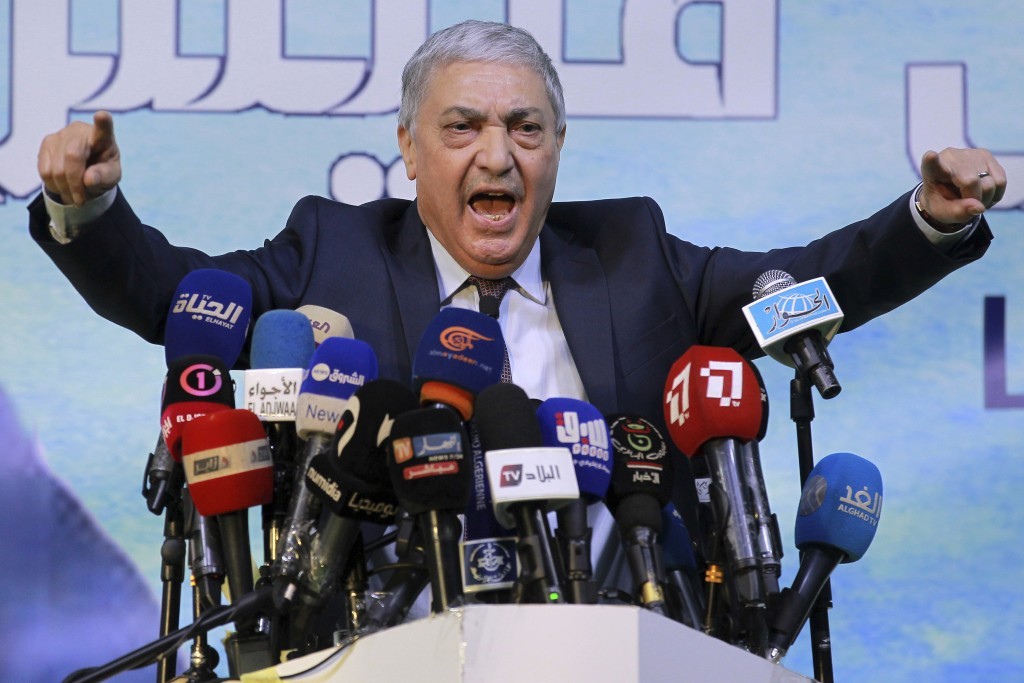 FILE - In this Nov.19, 2019 file photo, former Algerian Prime Minister Ali Benflis campaigns for the upcoming presidential election in Blida, south of...
