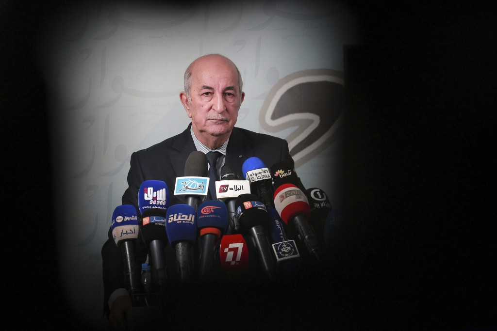 FILE - In this Nov. 24, 2019, file photo, Presidential candidate for the upcoming Dec. 12, presidential election Abdelmajid Tebboune gives a press con...