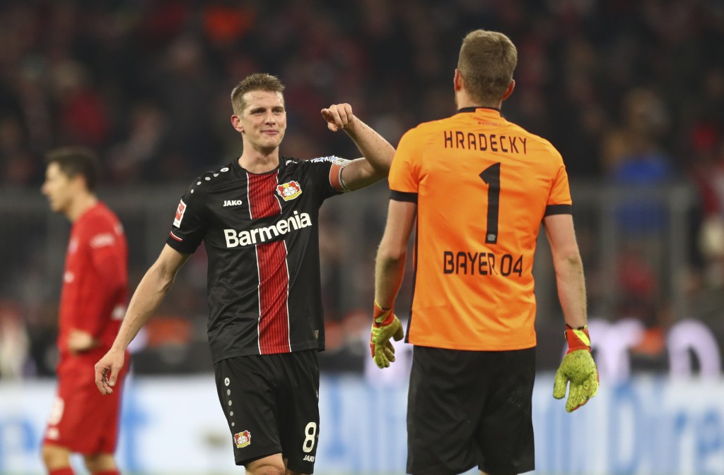 Leverkusen's Lars Bender points on Leverkusen's goalkeeper Lukas Hradecky after their victory in the German Bundesliga first devision soccer match bet...