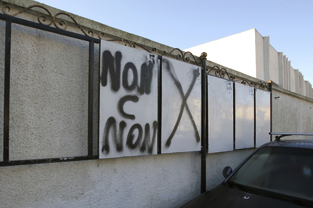 """In this Nov. 29, 2019, photo, a graffiti reads """"No is No"""" on electoral boards in Algiers. Algeria's presidential campaign is in trouble. Candidates ar..."""