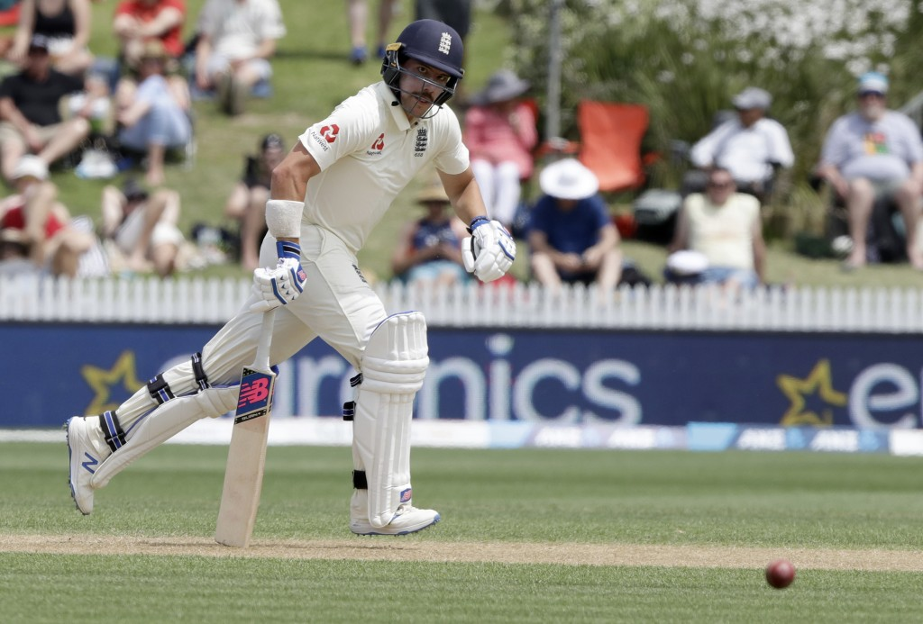 England's Rory Burns runs a single while batting during play on day three of the second cricket test between England and New Zealand at Seddon Park in...