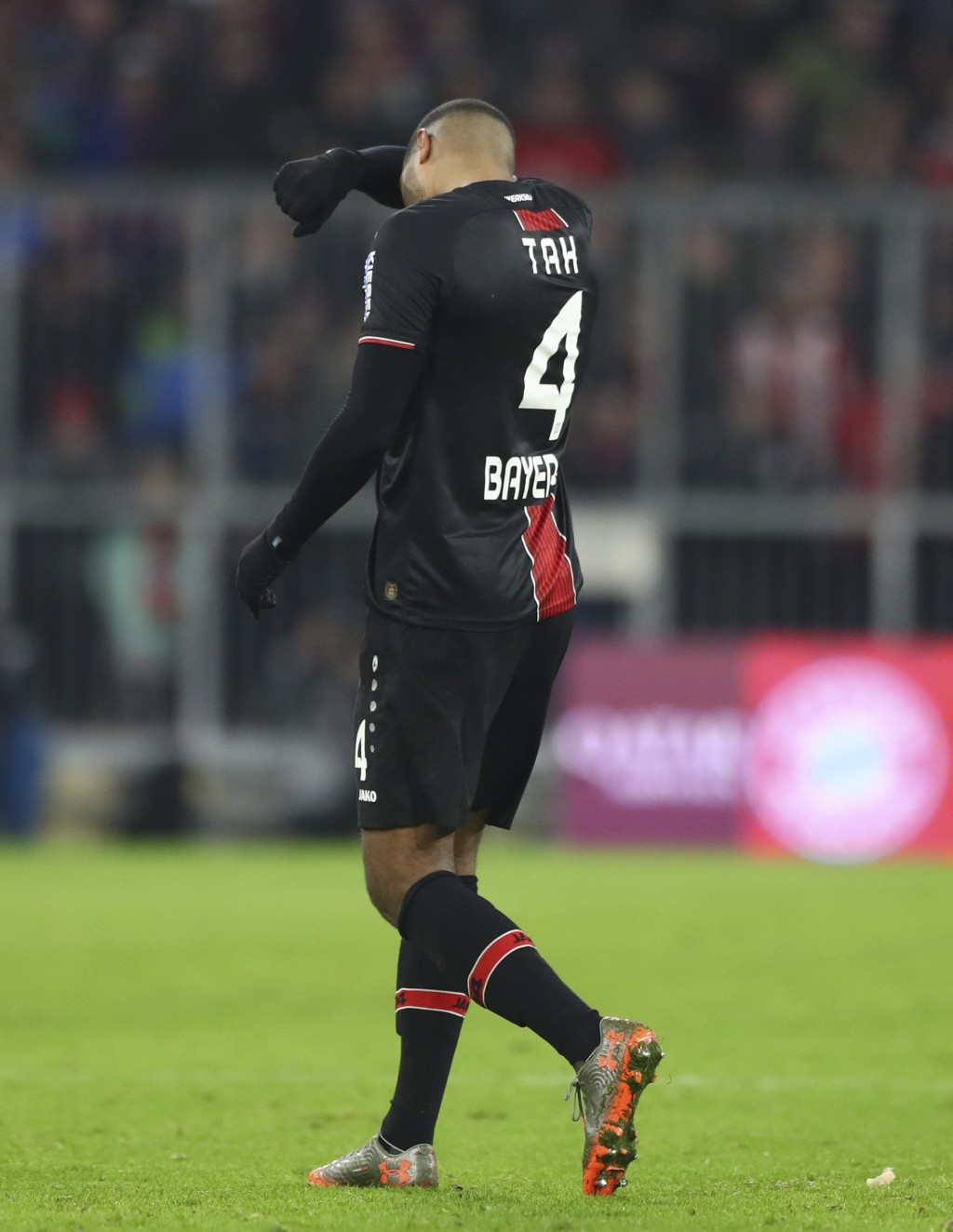 Leverkusen's Jonathan Tah walks off the pitch after he got the red card during the German Bundesliga first devision soccer match between FC Bayern Mun...