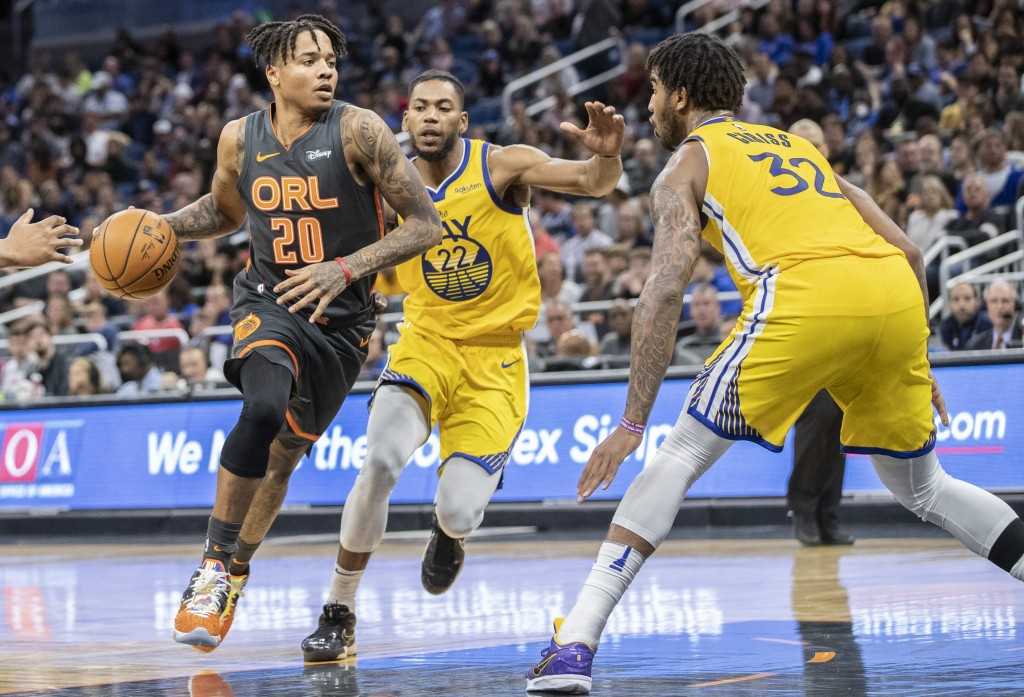 Orlando Magic guard Markelle Fultz (20) dribbles toward the basket on Golden State Warriors forward Glenn Robinson III (22) and forward Marquese Chris...