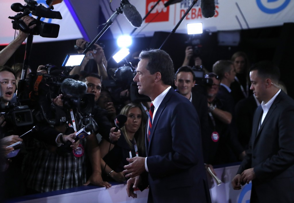 FILE - In this Tuesday, July 30, 2019, file photo, Montana Gov. Steve Bullock talks to reporters after the first of two Democratic presidential primar...