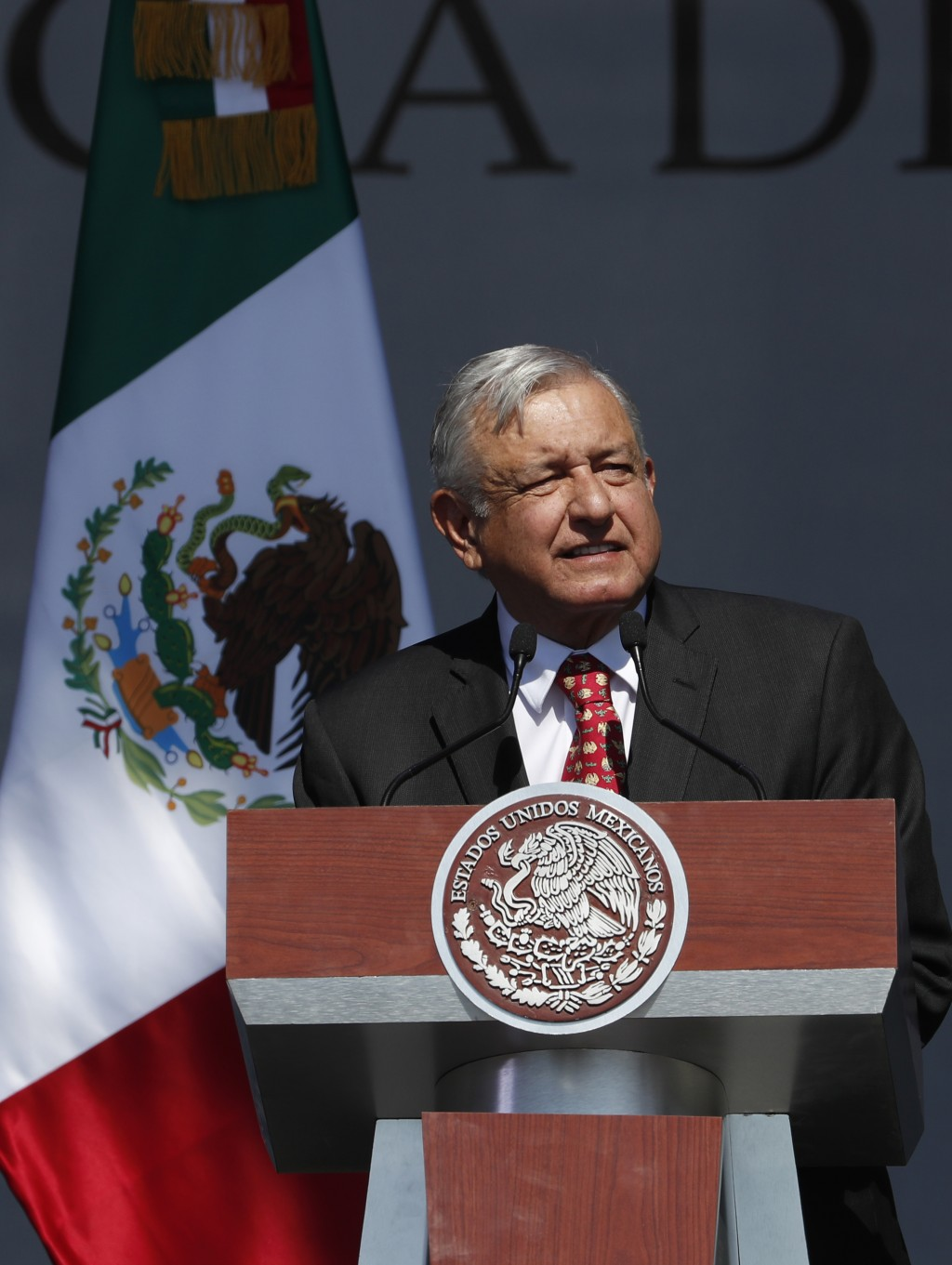 Mexico's President Andres Manuel Lopez Obrador speaks during rally to commemorate his one year anniversary in office, at the capital's main plaza, the...
