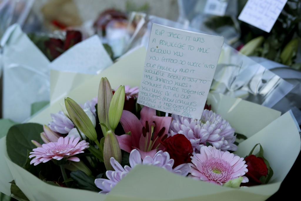 A tributes message with flowers, placed by the southern end of London Bridge in London, Monday, Dec. 2, 2019. London Bridge reopened to cars and pedes...