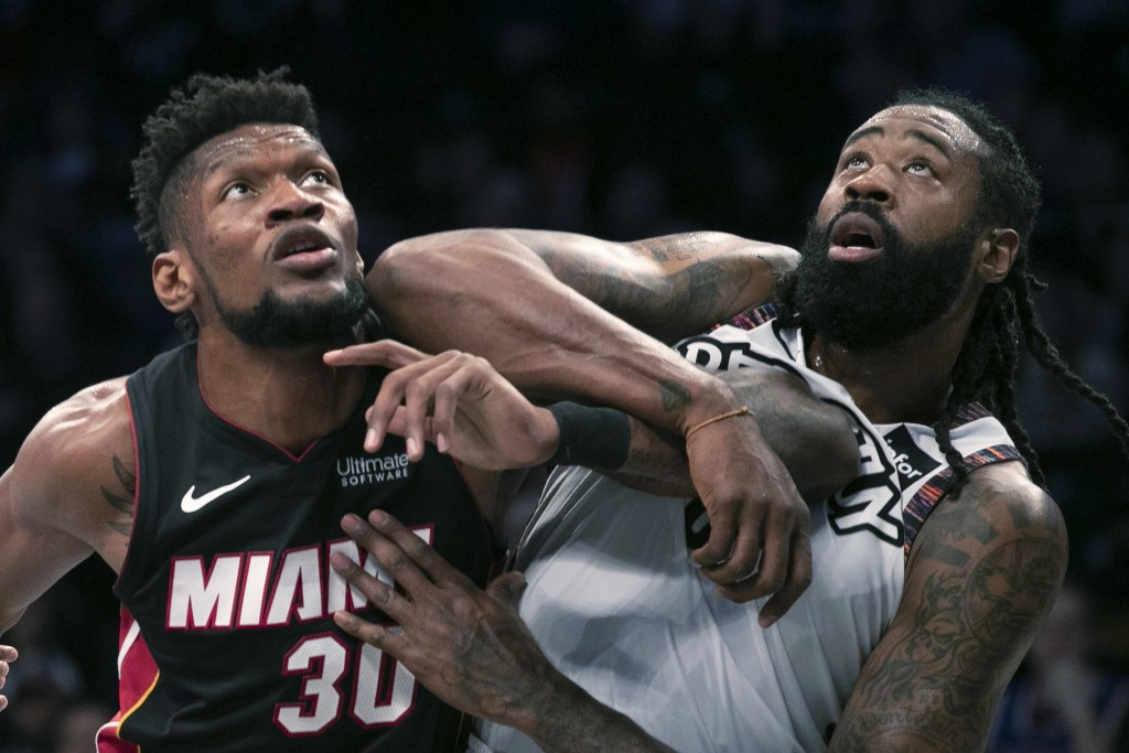 Miami Heat forward Chris Silva (30) catches an elbow from Brooklyn Nets center DeAndre Jordan (6) in the first half of a basketball game, Sunday, Dec....
