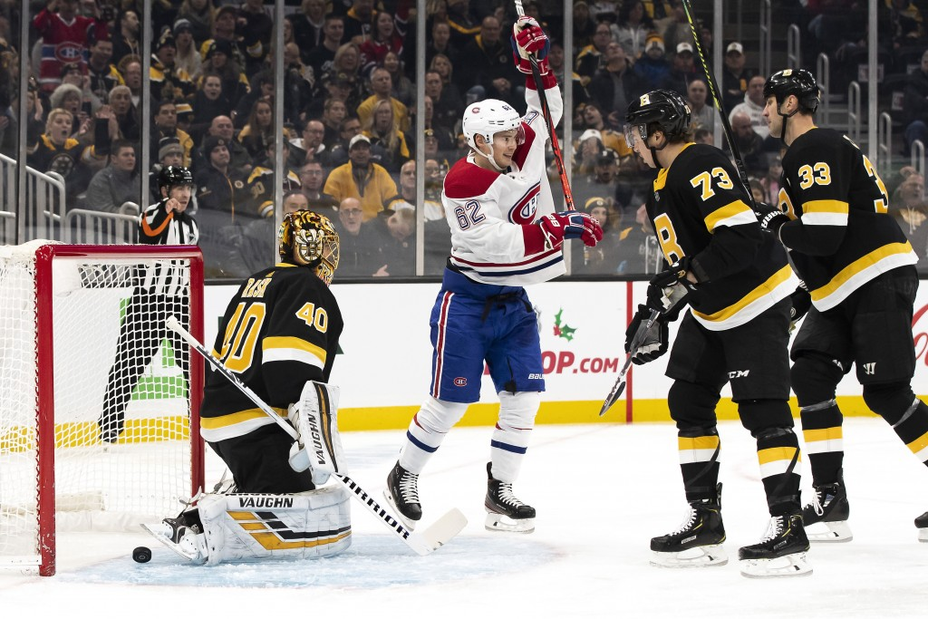 Montreal Canadiens' Artturi Lehkonen celebrates a goal by teammate Joel Armia against Boston Bruins' Tuukka Rask as Bruins defenseman Charlie McAvoy (...