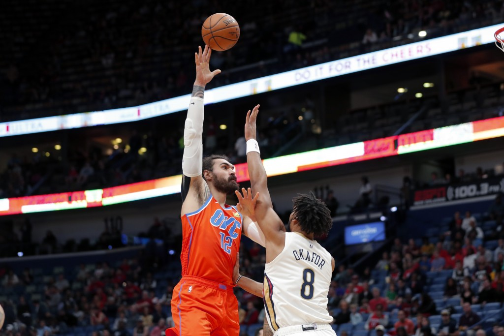 Oklahoma City Thunder center Steven Adams (12) shoots over New Orleans Pelicans center Jahlil Okafor (8) in the first half of an NBA basketball game i...