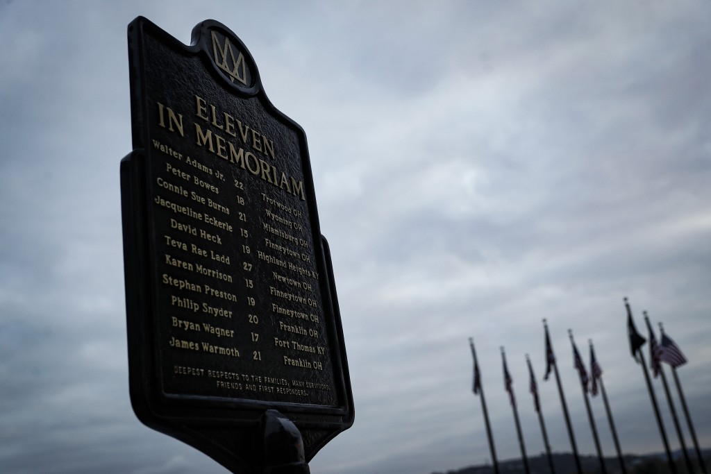 In this Wednesday, Nov. 20, 2019 photo, a memorial plaque for eleven concertgoers killed at a 1979 concert stands between Great American Ballpark and ...