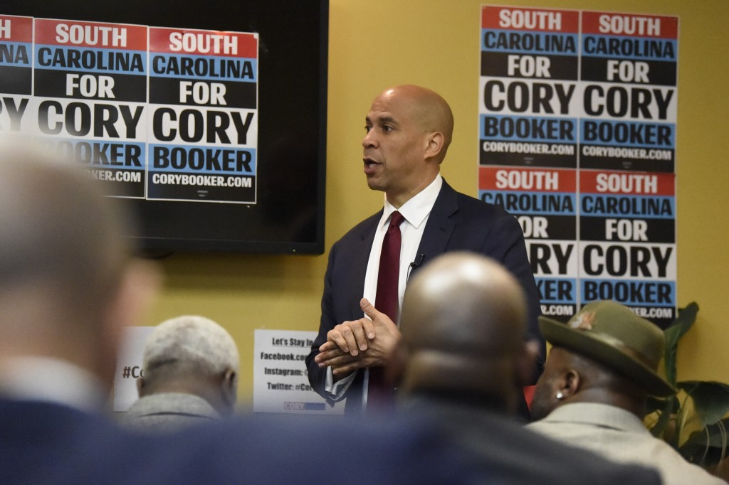 Democratic presidential contender Cory Booker speaks at a round table discussion on issues impacting black men on Monday, Dec. 2, 2019, at his campaig...