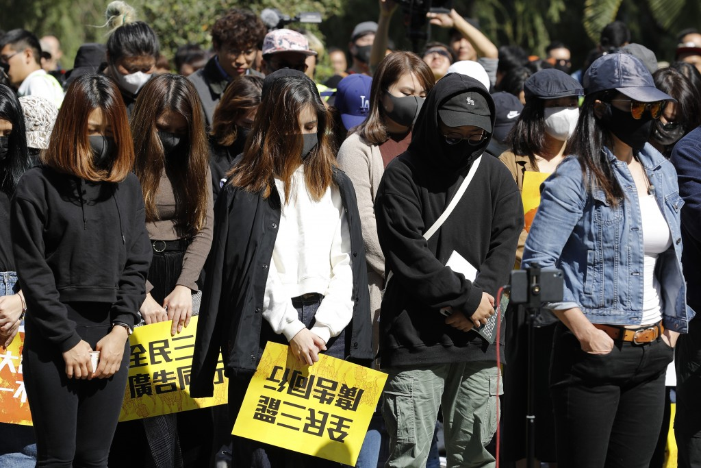 Pro-democracy supporters pause during a rally by the advertising industry in Hong Kong on Monday, Dec. 2, 2019. Thousands of people took to Hong Kong'...