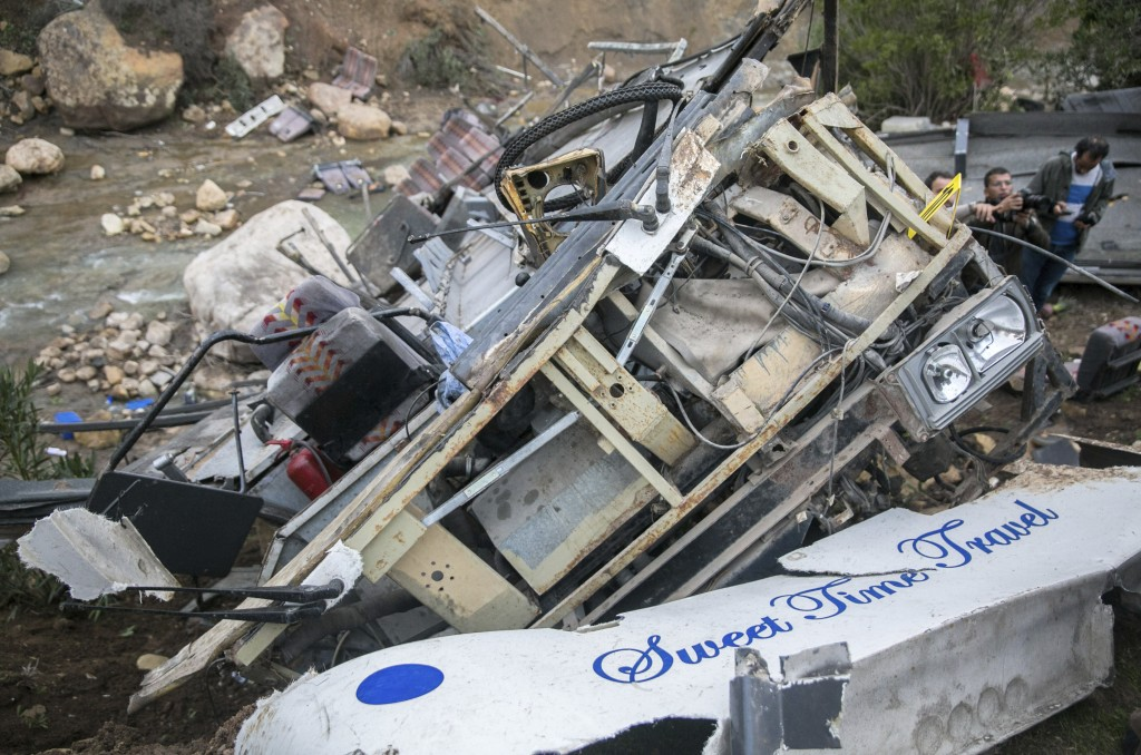 The debris of a regional bus that crashed off a hill are pictured Sunday Dec.1, 2019, causing the death of at least 22 local passengers who were on an...