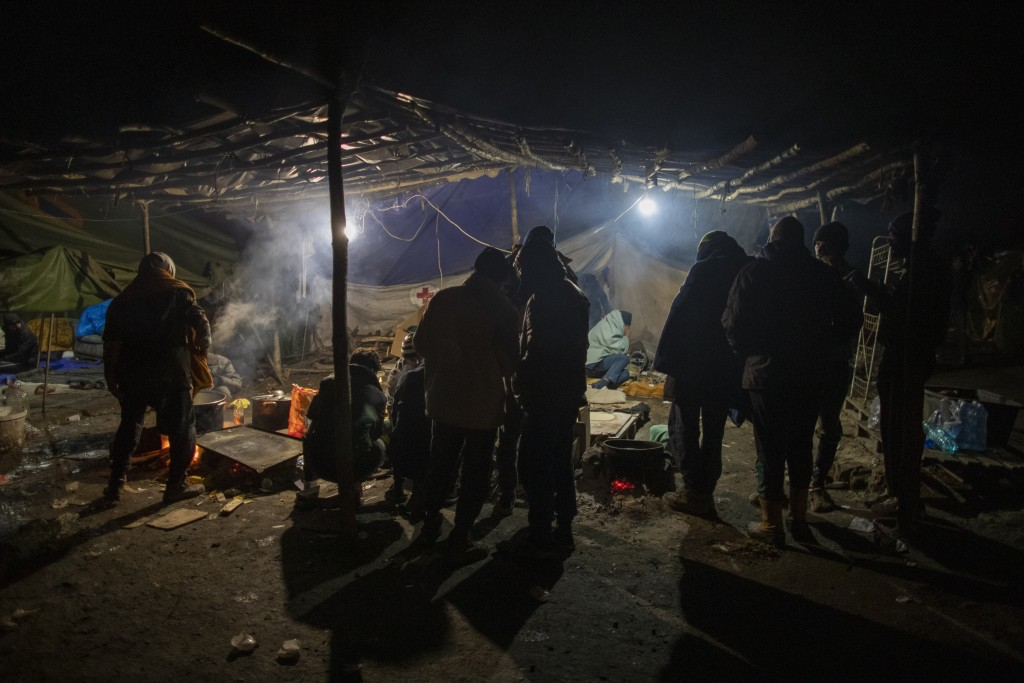 Migrants gather at the Vucjak refugee camp outside Bihac, northwestern Bosnia, Sunday, Dec. 1, 2019. Despite the approach of harsh weather, hundreds o...