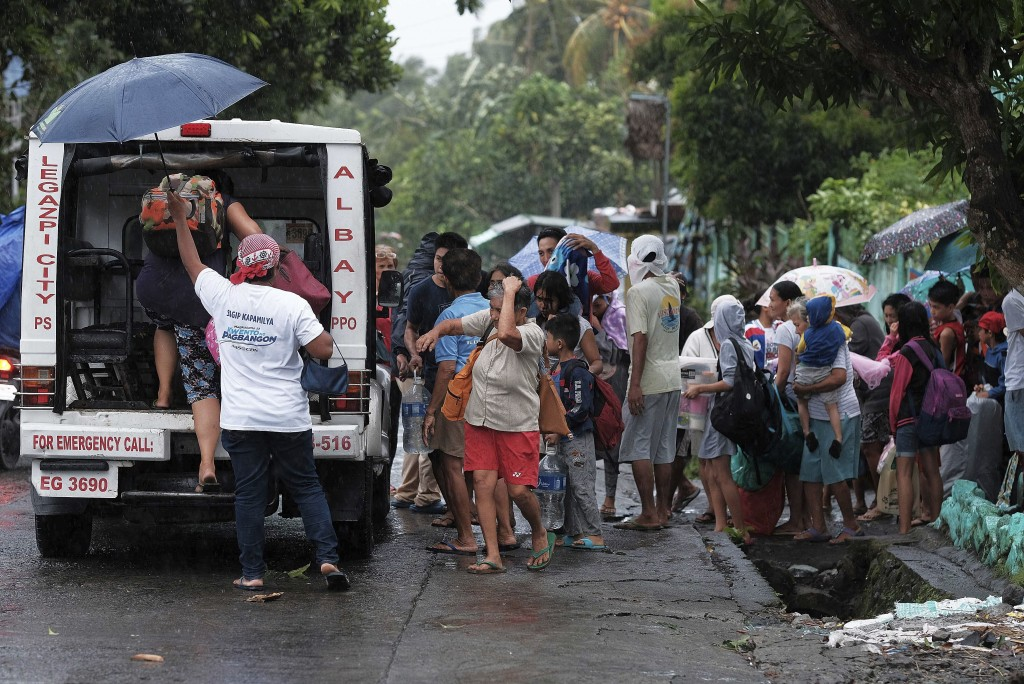 Residents evacuate their area in preparation for the coming of Typhoon Kammuri in Legazpi, Albay province, southeast of Manila, Philippines on Monday ...