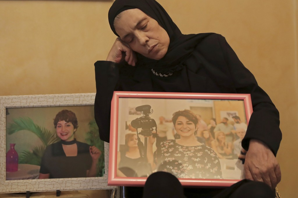 In this Nov. 17, 2019 photo, Majida holds a photo of her daughter Nadyn Jouny as she attends a 40 day mourning ceremony of her death in a car accident...