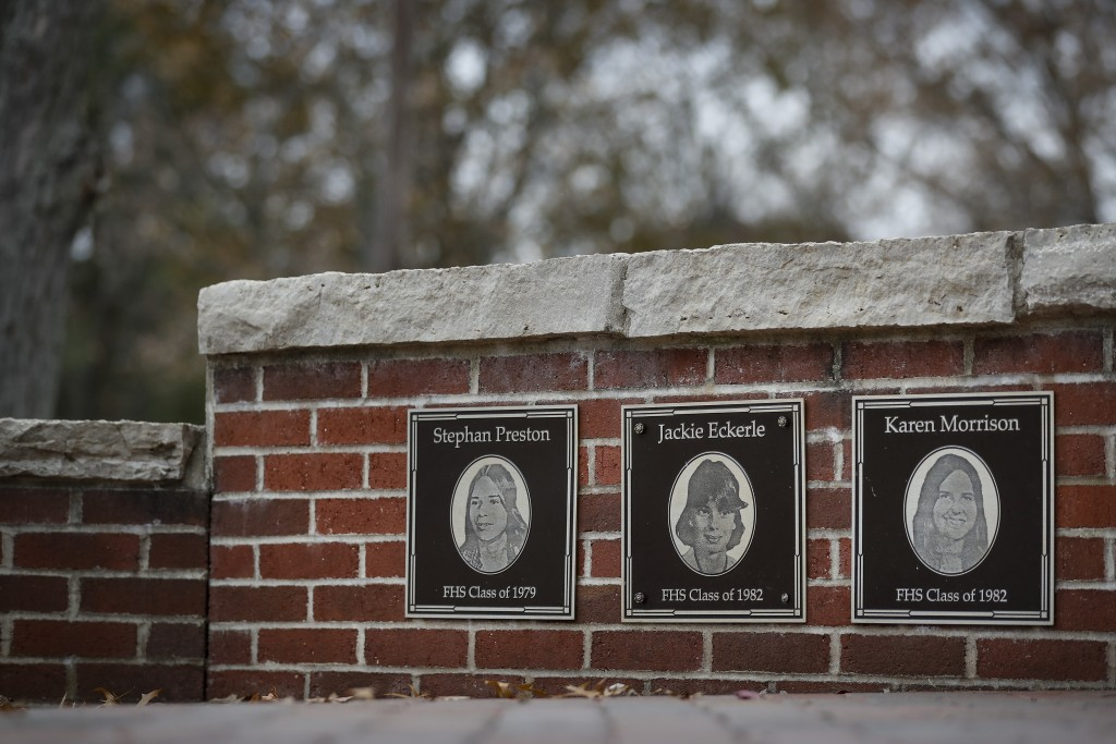 In this Thursday, Nov. 21, 2019 photo, the faces of the three Finneytown students killed in a stampede at The Who's Dec. 3, 1979 concert, are displaye...