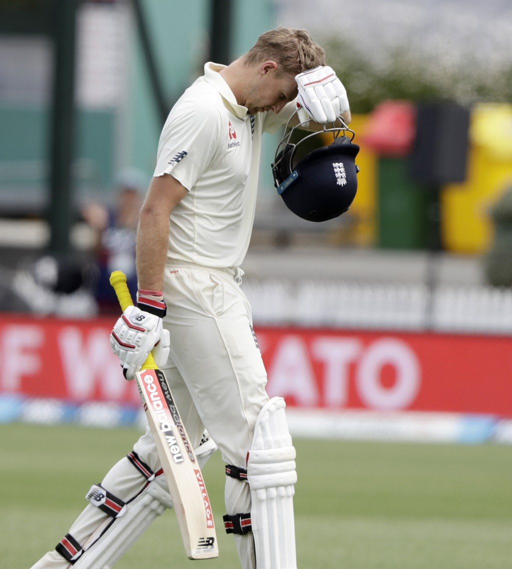 England's Joe Root leaves the field after he was dismissed for 226 runs during play on day four of the second cricket test between England and New Zea...