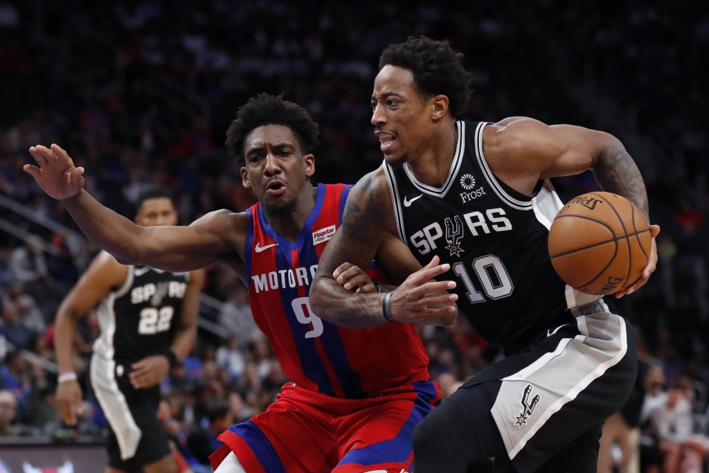 San Antonio Spurs guard DeMar DeRozan (10) drives on Detroit Pistons guard Langston Galloway (9) during the first half of an NBA basketball game, Sund...