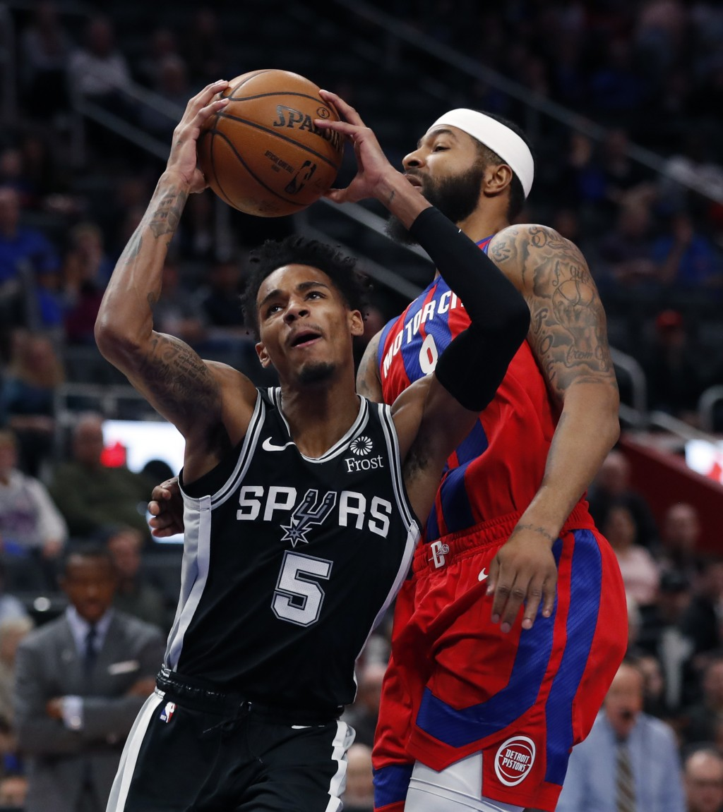 San Antonio Spurs guard Dejounte Murray (5) attempts a layup as Detroit Pistons forward Markieff Morris (8) defends during the first half of an NBA ba...