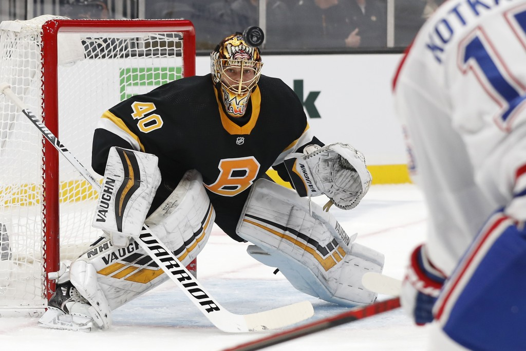 Boston Bruins goaltender Tuukka Rask watches the puck during the first period of an NHL hockey game against the Montreal Canadiens, Sunday, Dec. 1, 20...