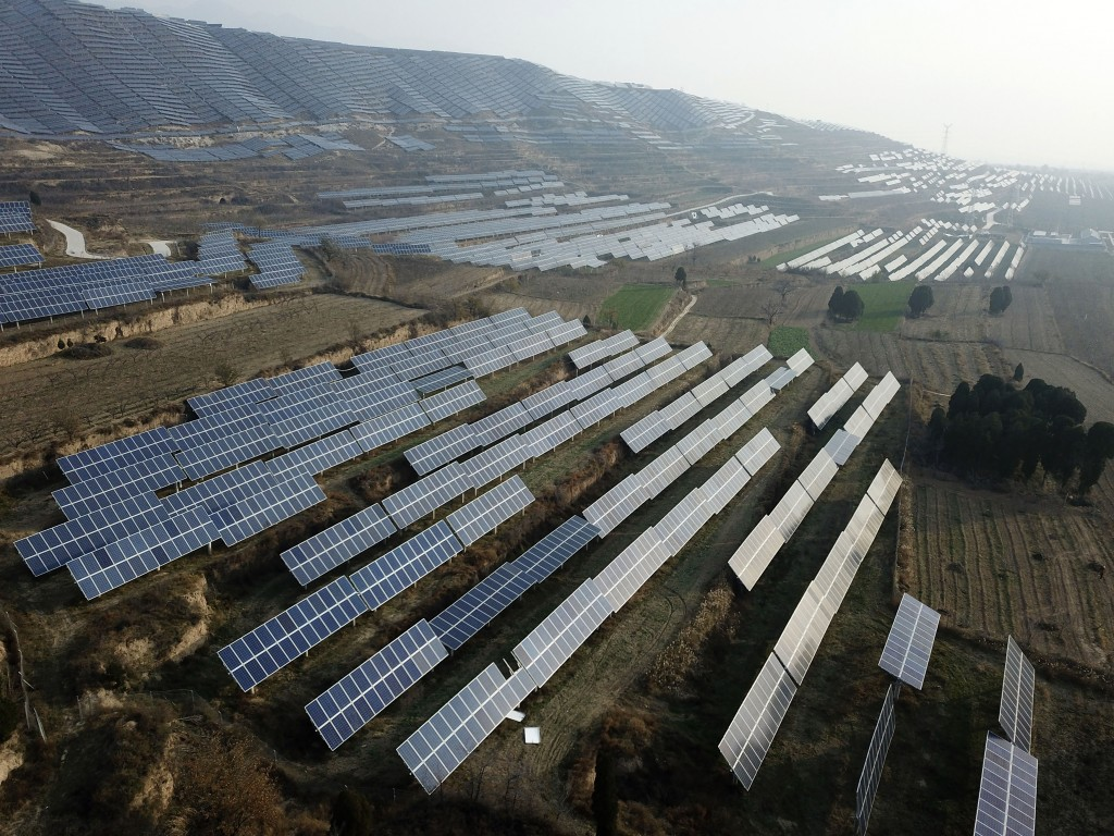 In this Nov. 28, 2019, photo, a solar panel installation is seen in Ruicheng County in central China's Shanxi Province. As world leaders gather in Mad...