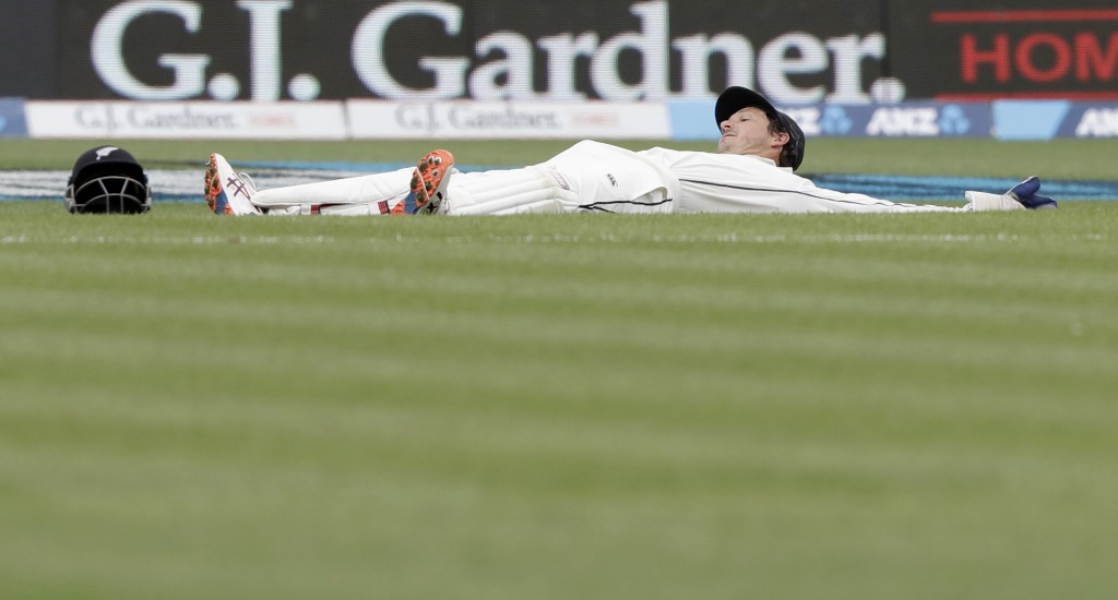 New Zealand's BJ Watling reacts after a ball went past him during play on day four of the second cricket test between England and New Zealand at Seddo...