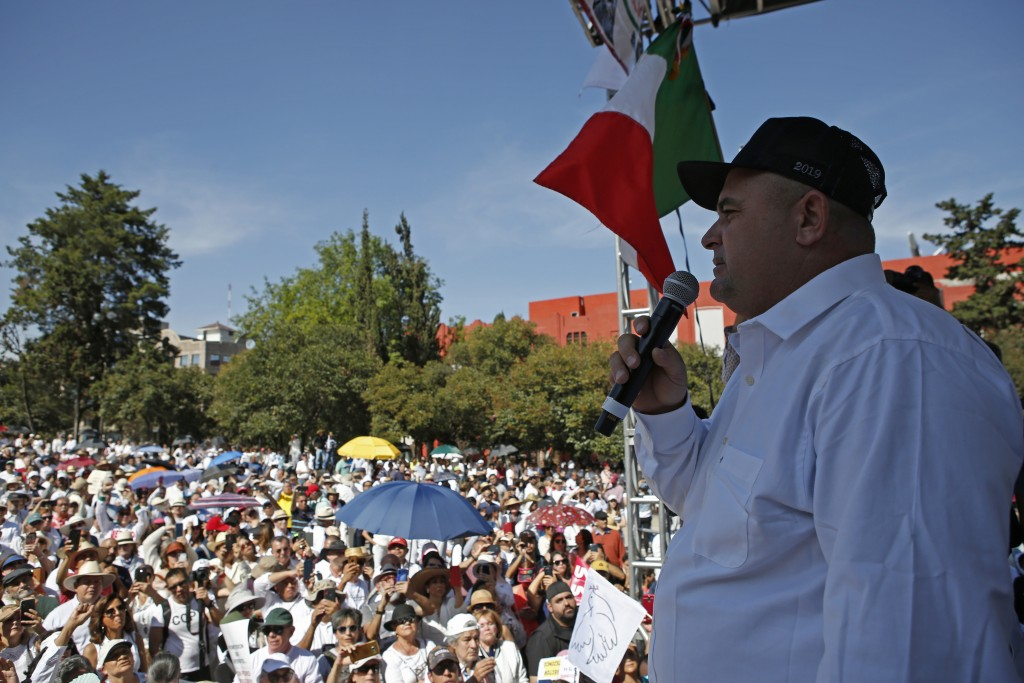 Julian LeBaron speaks during a protest against the first year in office of Mexico's President Andres Manuel Lopez Obrador, in Mexico City, Monday, Dec...