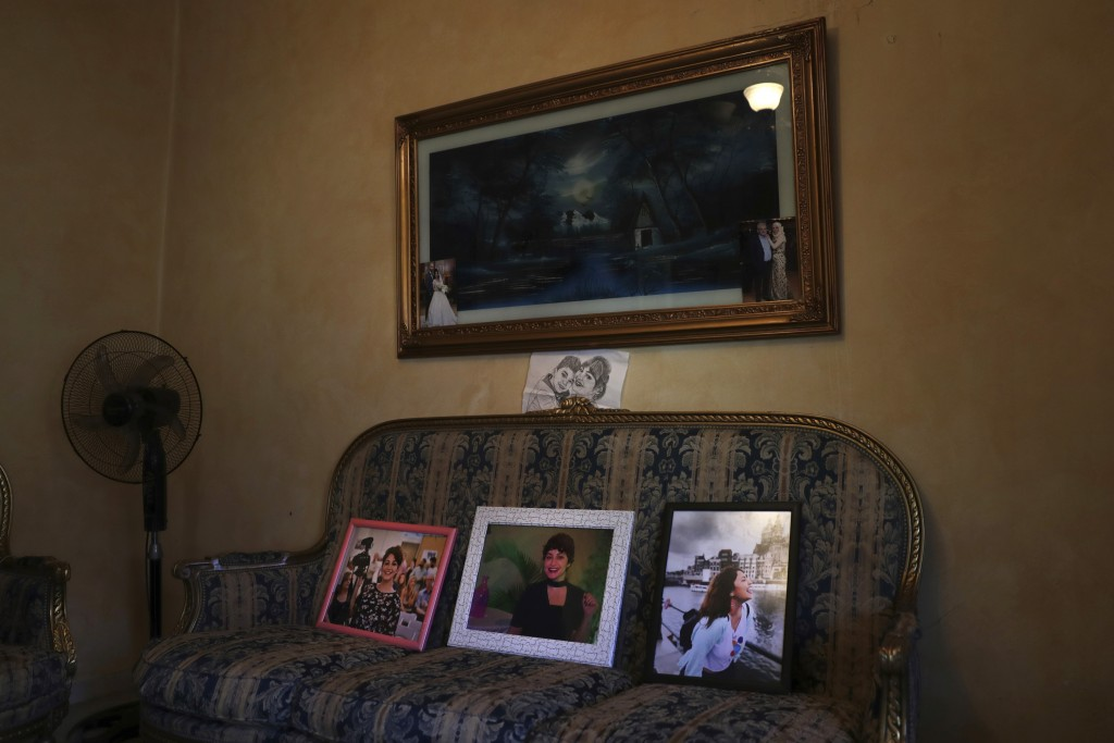 In this Nov. 17, 2019 photo, the family of Nadyn Jouny displays photos of her, at a 40 day mourning ceremony of her death in a car accident, at their ...