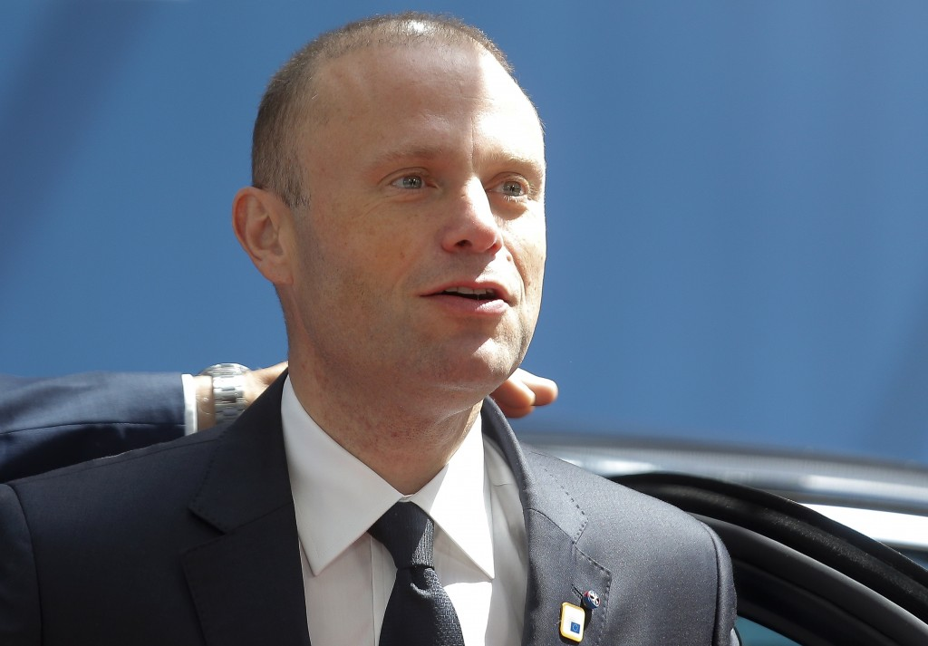 FILE - In this Thursday, June 20, 2019 file photo, Malta's Prime Minister Joseph Muscat arrives for an EU summit at the Europa building in Brussels. M...