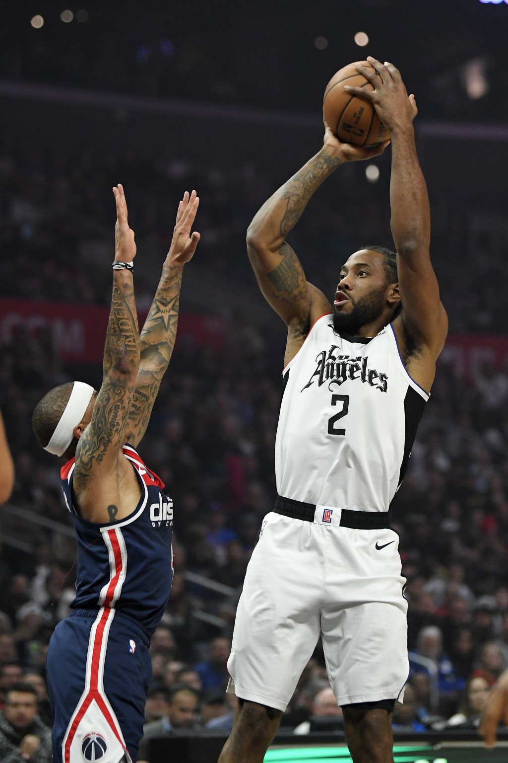 Los Angeles Clippers forward Kawhi Leonard, right, shoots as Washington Wizards guard Isaiah Thomas defends during the first half of an NBA basketball...
