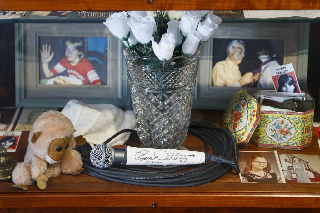 In this Thursday, Nov. 21, 2019 photo, a signed microphone by The Who's Roger Daltrey is displayed in a memorial cabinet at the Finneytown High School...