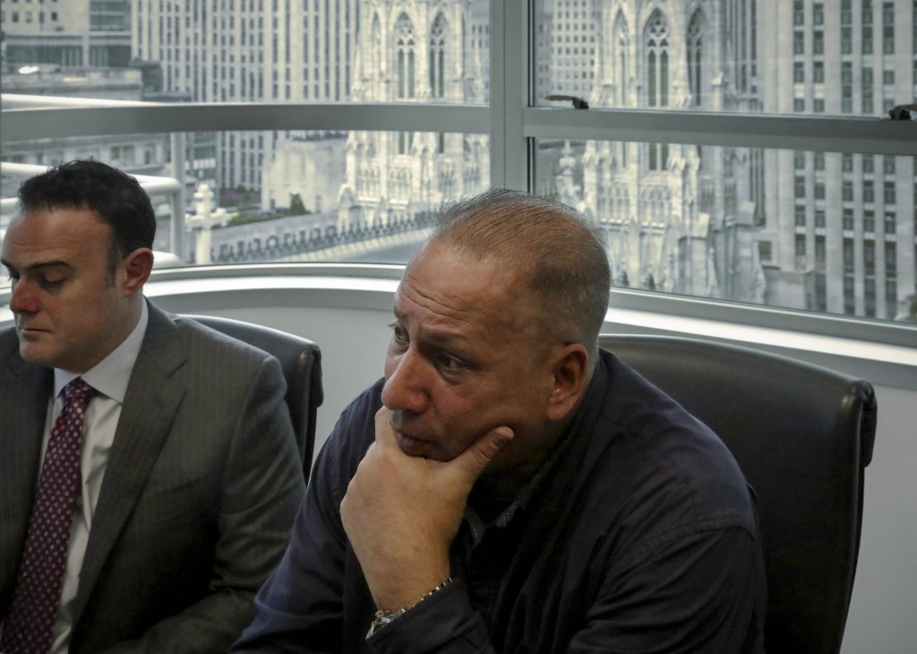 In this Tuesday, Oct. 29, 2019, photo, Ramon Mercado, right, recalls childhood clergy sexual abuse while his lawyer, Adam Slater, left, takes notes du...
