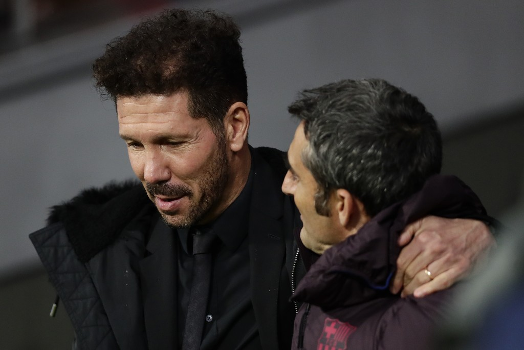 Atletico Madrid's head coach Diego Simeone, left, talks with FC Barcelona's head coach Ernesto Valverde during a Spanish La Liga soccer match between ...