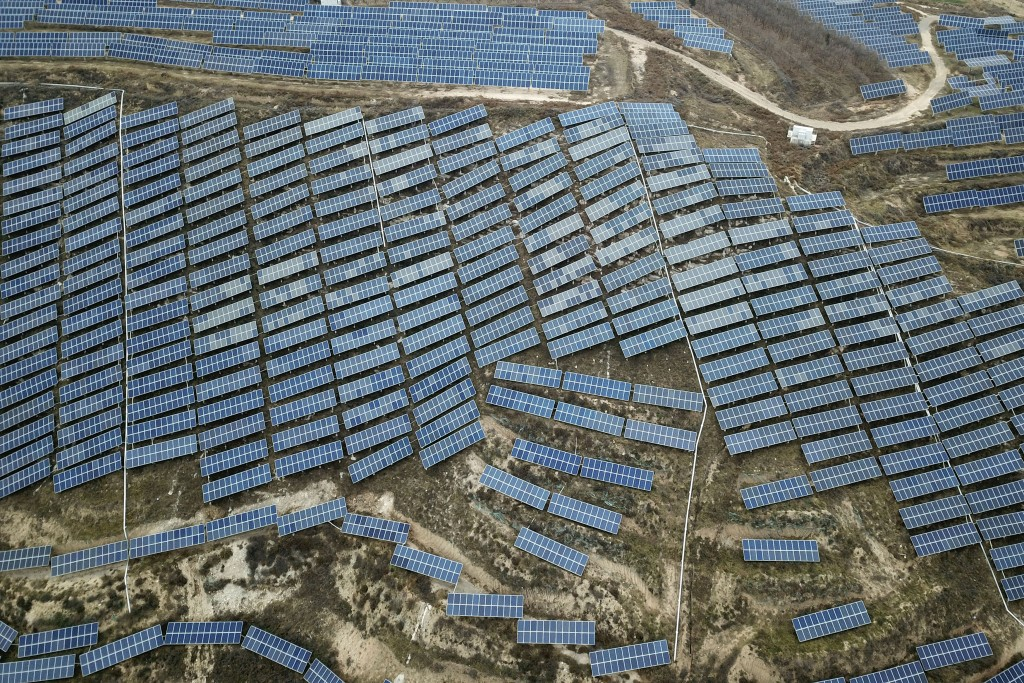 In this Nov. 27, 2019, photo, a solar panel installation is seen in Ruicheng County in central China's Shanxi Province. As world leaders gather in Mad...