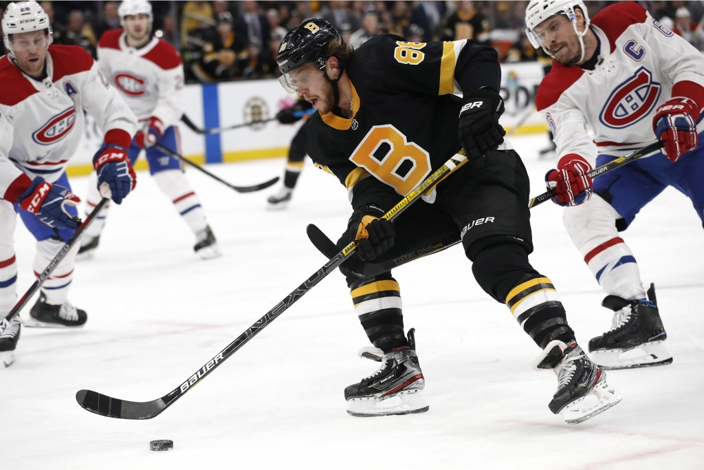 Boston Bruins' David Pastrnak goes around Montreal Canadiens defenseman Shea Weber during the second period of an NHL hockey game Sunday, Dec. 1, 2019...