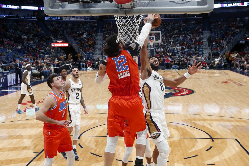 Oklahoma City Thunder center Steven Adams (12) blocks a shot by New Orleans Pelicans center Jahlil Okafor (8) in the first half of an NBA basketball g...