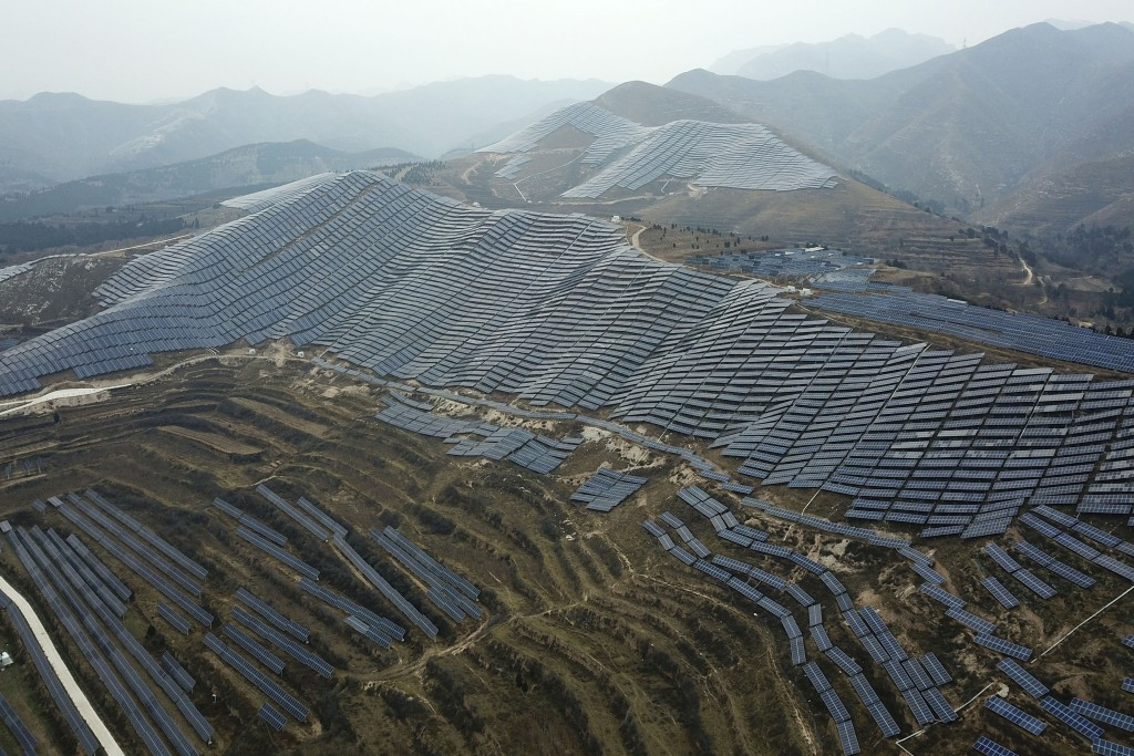 In this Nov. 27, 2019, file photo, a solar panel installation is seen in Ruicheng County in central China's Shanxi Province. As world leaders gather i...