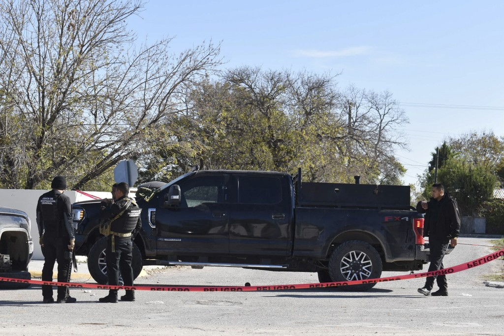 Police block a road in VIlla Union, Mexico, Sunday, Dec. 1, 2019, the day after it was assaulted by gunmen. Mexican security forces on Sunday killed s...